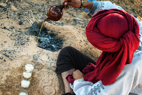 Berber man pouring mint tea from height