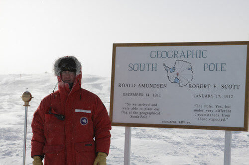 Ralf at the pole marker in Antarctica