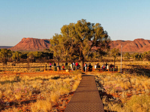 Tourist at Kings Canyon Resort Sunset viewing area, West Macdonnell Rangers in Northern Territory Australia