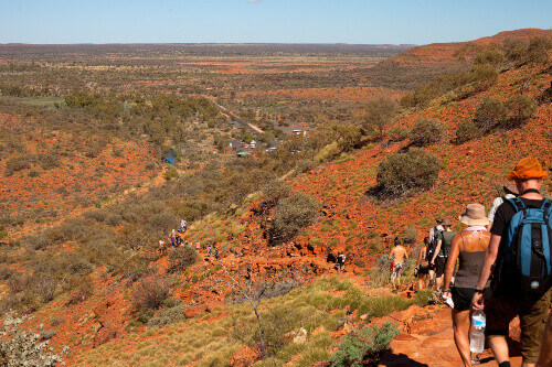 Tourists walking down the path with their guide in Kings Canyon Australia