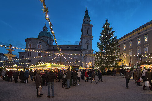 Christmas market at Residenzplatz square close to Salzburg Cathedral in Salzburg Austria