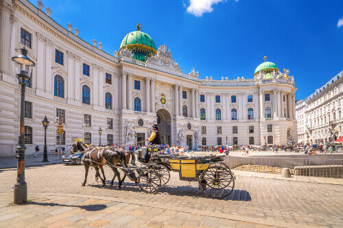 Hofburg Palace Complex with horse drawn carriage in Vienna Austria