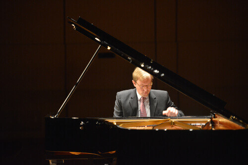Professor Jan Jiracek von Arnim playing piano