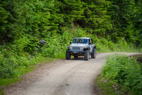 Tourists in a jeep on a safari tour in Parberry Mountain in Blue River British Columbia Canada