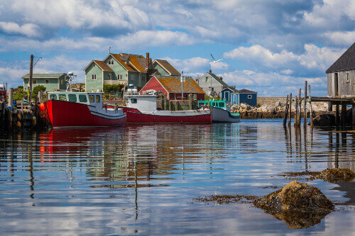 Summer view of fishermen houses and harbour at Peggys Cove or Fishermens Cove in Halifax Nova Scotia Canada