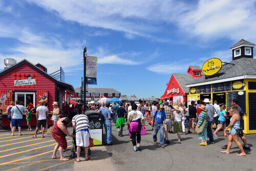 The historic Halifax waterfront contains several food stores and is a popular spot for tourists and locals in Halifax Canada