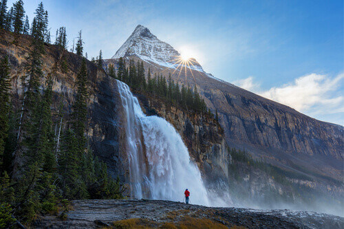 A man stand before Emperor Falls and Mount Robson Emperor Ridge in Canadian Rocky Mountain British Columbia Canada
