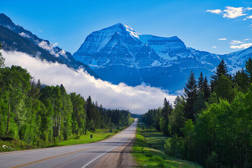 Road to Mount Robson with low hanging clouds in British Columbia Canada