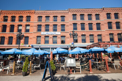 Summer day along the Market Square Boardwalk in Grannans Seafood Restaurant in downtown Saint John New Brunswick in Canada