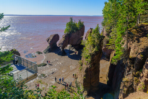View of Hopewell Rocks at low tide, with visitors in Hopewell Cape New Brunswick, Canada