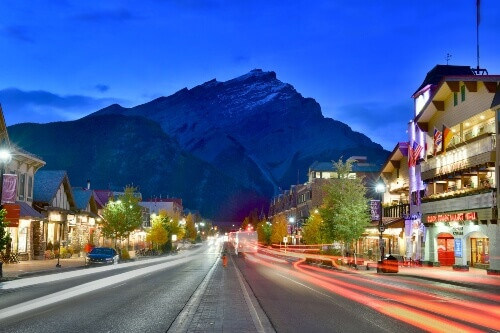 Street view of famous Banff Avenue at night in Alberta Canada