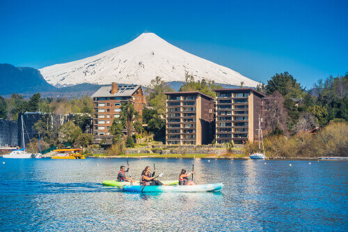 Group of tourists paddling on a kayak in Lake Villarrica, Pucon, Chile.