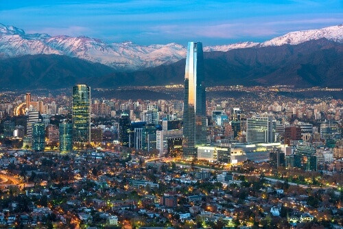 Panoramic view of Providencia and Las Condes districts with Titanium Tower and Los Andes Mountain Range in Santiago de Chile
