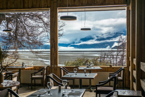 A hotel restaurant with the view of Lake Grey in Torres del Paine National Park Chile