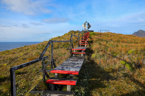 Wooden path leading towards the Cape Horn Memorial Sculpture on Cape Horn Island in Chile