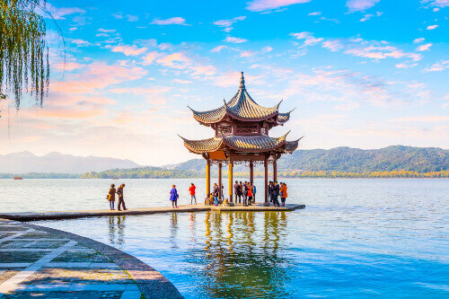 People lining up in a Pagoda in the beautiful west lake of Hangzhou in China
