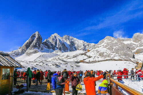 Tourists travel to the summit of the snow-capped Jade Dragon Snow Mountain in Lijiang Yunnan China