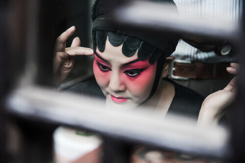 Close-up of a chinese opera actress is doing make up in Suzhou China