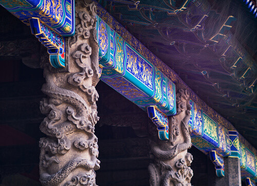 Coiled dragon pillars in front of Dacheng Hall in Temple of Confucius a UNESCO World Heritage Site in Qufu Shandong China