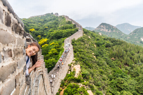 Tourist having fun and waving at the Great Wall of China in Badaling China