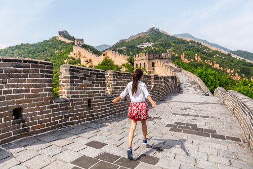 Tourist having fun at the Great Wall of China