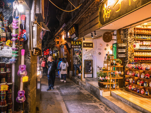 Tourist walking in alley building district of Fenghuang ancient town in China