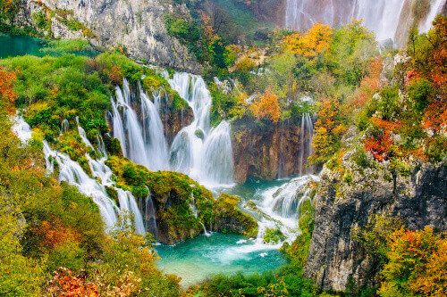 Detailed view of the beautiful waterfalls in the sunshine during autumn in Plitvice National Park Croatia