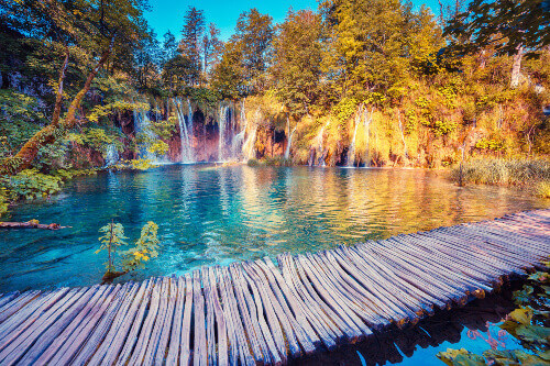 Majestic view of turquoise water and sunny beams in the Plitvice Lakes National Park in Croatia