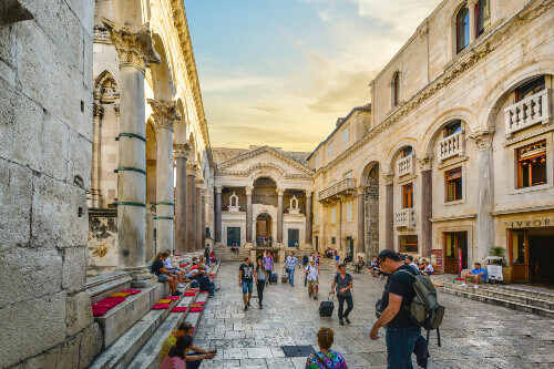 Tourists and locals enjoy an afternoon in Roman Peristil square in Docletians Palace in Split Croatia