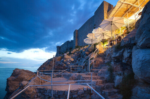 Buza beach cafe is one of the most beautiful bars in Dubrovnik which hangs on the cliffs overlooking the Adriatic sea in Dubrovnik Croatia