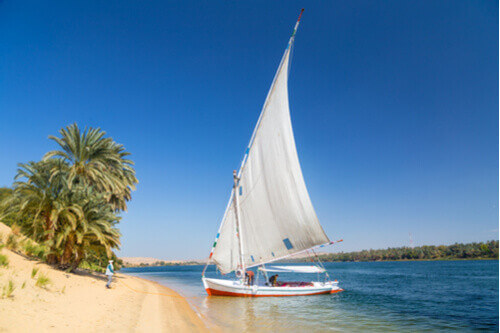 Felucca Traditional Wooden Sailboat on the shore of Nile River Egypt