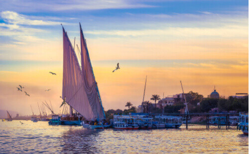 Felucca sailing on a lovely sunset in Nile Egypt