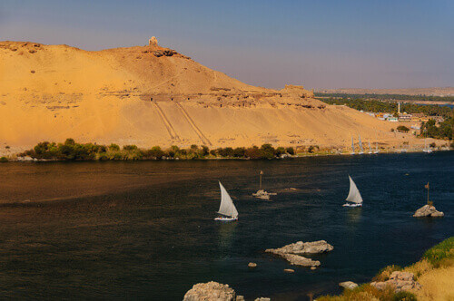 Feluccas sailing on the Nile River in Aswan Egypt