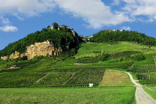 Home of the famous yellow wine in Chateau Chalon on top of the cliff in Departement Jura Franche Comte France