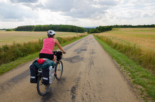 Bikers with panniers cycling near Noyers in Burgundy France
