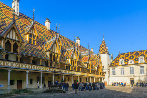 The Hospices of Beaune (historic hospital) with visitors for the wine auction in Beaune Burgundy France