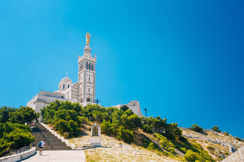 Catholic Basilica of Our Lady of the Guard or Notre Dame De La Garde church at hill in Marseille France