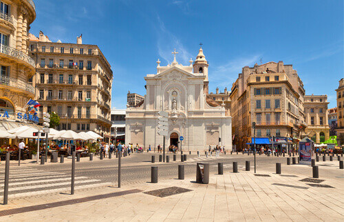 Old port with church, cafes and restaurants in Marseille France