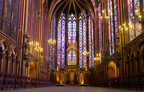 Illuminated interior of the Sainte Chapelle in Paris France
