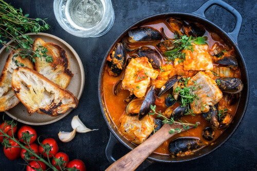 Bouillabaisse a traditional french corsican seafood stew with mussels and garlic baguette