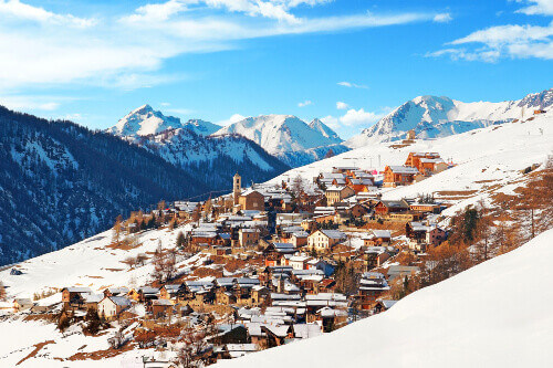 The village and beautiful mountain slopes of Saint-Véran in snowy winter in France