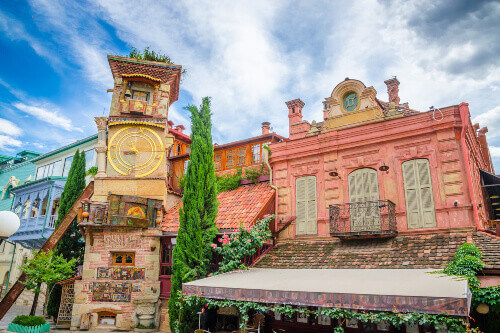 Beautiful Clock Tower of puppet theater Rezo Gabriadze in historical center of old Tbilisi Georgia