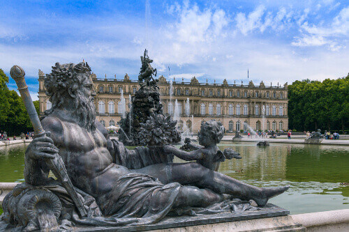 Fountain in the castle gardens and park in Insel Herrenchiemsee island Chiemsee lake Chiemgau in Bavaria Germany
