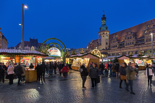 Christmas market at Marktplatz (Market square) in front of the Old Town Hall at dusk in Liepzig Germany