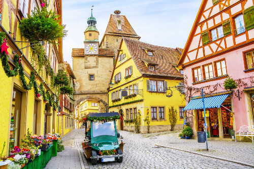 Retro car and old houses decorated for Christmas holiday in Rothenburg ob der Tauber in Bavaria Germany