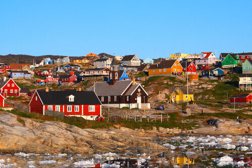Ilulissat is the biggest island in the world, with Zion Church in the background in Ilulissat, Greenland
