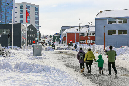 Central pedestrian street with modern building and shops in Nuuk city, Greenland