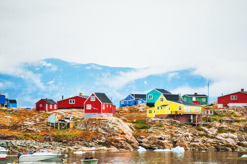 Colorful houses in Saqqaq village travelled by boat in Western Greenland
