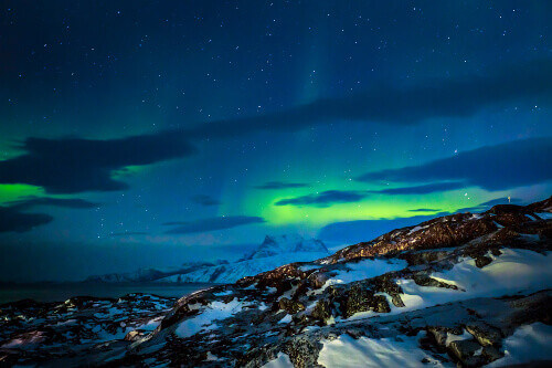Northern lights over the fjord and mountains in Nuuk the capital city of Greenland