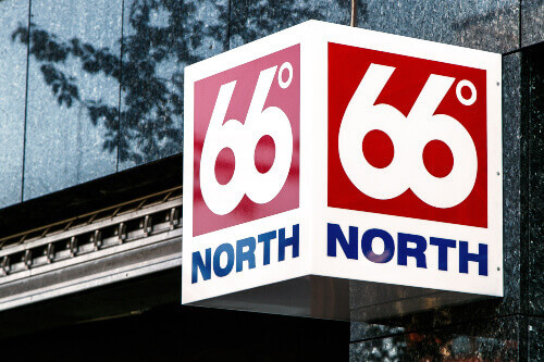 66 degrees North sign is attached to the wall above the entrance to the retail clothing store in Reykjavik Iceland